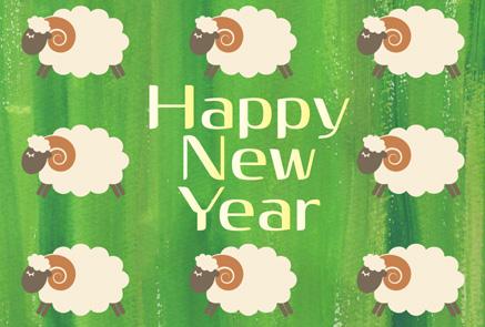 グリーン背景の羊イラスト年賀状